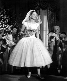 Inspirasi tea length dress yang dikenakan Audrey pada malam launching ILnet adalah gaun pengantin Audrey Hepburn di Funny Face. --- #MissRekomendasi is now online on http://www.storial.co/book/miss-rekomendasi
