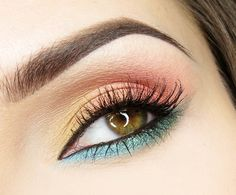 I think if you softened the lower lash line color a bit this could be a really wearable look for Spring.