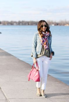 Casual spring fashion: Bleached denim jacket, neutral button-down shirt, white skinny jean, colorful scarf
