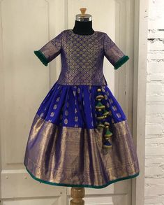 A rich purple kaanchi pattu detailed with zari blouse embellished with zardosi and green thread work… Kids Dress Wear, Kids Gown, Kids Wear, Baby Frocks Designs, Kids Frocks Design, Baby Dress Design, Frock Design, Frocks For Girls, Little Girl Dresses