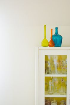 Jorinde's home, painted an old cabinet white and yellow, photo by Jorinde Reijnierse