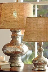 Make your vases and lamps look like mercury glass by spritzing with water, and then doing a coat of Krylon Looking Glass spray paint. | 33 Ways Spray Paint Can Make Your Stuff Look More Expensive