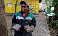 Nzambi Matee hurls a brick hard against a school footpath constructed from bricks made of recycled plastic that her factory turns out in the Kenyan capital.
