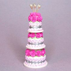 Pink, white and silver 1:12 polymer clay three tier dollhouse miniature wedding cake dolls house food. $39.00, via Etsy.