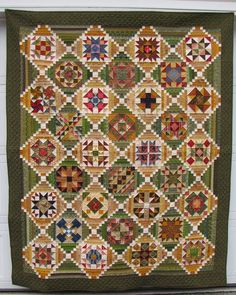 Backstory, abbreviated: I started this quilt in 2007 as a block of the month. It's the Golden Memories sampler designed by  Lori Smith,...