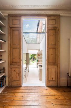 Rustic door leading into the side extension showing a combination of various materials and the amount of light shining into the extension through roof lights. House Extension Design, Glass Extension, House Design, Extension Ideas, Victorian Terrace House, Edwardian House, Georgian Homes, Victorian Homes, Side Return Extension
