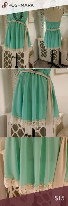 Super cute mint Agaci  dress with lace bottom Super cute mint green Agaci Dress NWT. it has a cream sheer belt to match  cream lace around the bottom. Agaci  Dresses Strapless