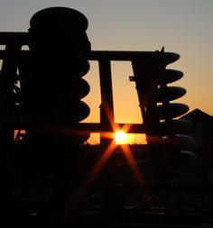 Sunrise thru farm equipment...........