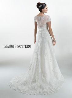 Lace applique A-line wedding dress, Glenda by Maggie Sottero, featuring illusion lace sleeves and an illusion sweetheart neckline. Finished with detachable satin belt with bow detail.