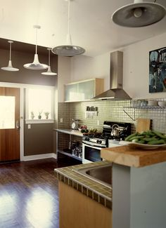 Like the colour scheme. It needs a big salvaged wood island in the middle. Do not like the lights and would never have a tiled counter. Green Kitchen Designs, Interior Design Kitchen, Kitchen Styling, Kitchen Decor, Kitchen Ideas, Kitchen Tile, Contemporary Decor, Contemporary Kitchens, Bistro Restaurant