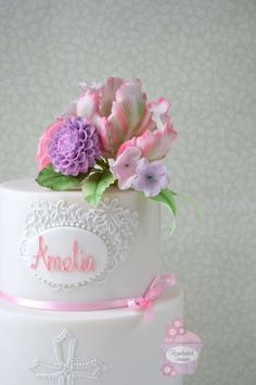 Christening cake decorated with sugar parrot tulip, pompom dahlia and ranunculus, with lace brush embroidery inspired by Amelia's Christening gown.
