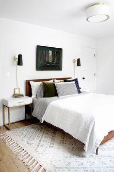 white modern bedroom with dark pops of color