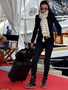 Au revoir! Adriana Lima was seen making her way off a yacht as she departed Cannes, France, on Saturday