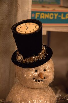 I love the clock face on this top hat! this would be fun to wear, or display for a New Years party.