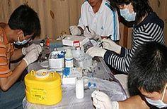 Virus, ecco come lavorano gl scienziati nel laboratorio di Wuhan: ma poi spariscono le foto