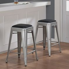 @Overstock.com - Tabouret 24-inch Padded Metal Counter Stool (set of 2) - Add a modern look to your counter with these Tabouret stools. A bonded leather padding and scratch and mark resistant finish completes this set of two stools.  http://www.overstock.com/Home-Garden/Tabouret-24-inch-Padded-Metal-Counter-Stool-set-of-2/6552128/product.html?CID=214117 $99.99