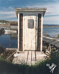 Durrell Outhouse white weathered on the edge of lake ocean, river, Outside Toilet, Girl Scout Camping, Box Houses, Outdoor Sheds, Newfoundland, Little Houses, Wilderness, Old Things, Barn
