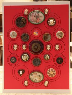 Board of assorted materials.  Large Bakelite button with metal star in the center and top and bottom feature polymer clay buttons of Kate Greenaway designs handmade by Ralph DeCew.