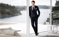 """""""Windows lined two walls of the main living space revealing the view of the lake and the mountains rising on the opposite shore.""""  ---Karl's story   Mens Fashion Suits Style Men's fashion blog - part"""