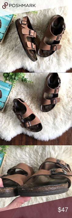 Birkenstock • Milano Slingback Sandals Cute medium-brown leather Birkenstock Milano sandals. All three straps have adjustable buckles. These are in fair condition, because they have been broken in a little bit. The straps look pretty nice except for a couple light smudges and a pen mark on the right shoe. The footbed is coming up in a couple of places (see photos for details.) euro size 36, according to the Birkenstock size chart, that's a 5-5.5. These fit most like a 5.5, even 6 in my…