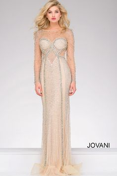 43730ff91f5 Stunning floor form fitting fully beaded nude evening dress features long  sheer sleeves