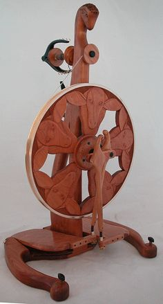 Golding 'Flock of the Shepherdess' Spinning Wheel - absolutely beautiful but $5750.  Maybe when we win the Lottery!
