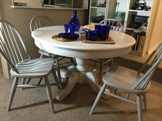 Pedestal Table and chairs. White chalk paint top. Linen white base. Chairs are aged grey with dark wax