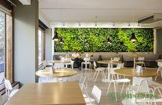 Green Fortune plantwall / vertical garden in restaurant, food retail. Finland.