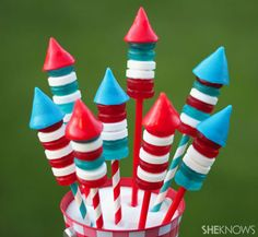Candy Poppin' Bottle Rockets for the Fourth of July {Tutorial} Taste the explosion on July Fourth with these candy bottle rockets. Just fill drinking straws with Pop Rocks, stack patriotic-colored Life Savers and add some cone-shaped Airhead candies on top. KABOOM! A clever treat that's fun and sweet to eat.