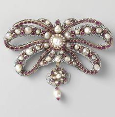Ruby, enamel and pearl XVII century brooch.  Via Rijsk Muséum