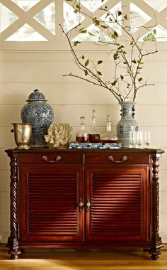 An heirloom piece that could anchor any room, our exclusive Double Forsyth Bar Cabinet is richly finished with British Colonial details and thoughtfully outfitted for multifunctional use. | Frontgate Interiors