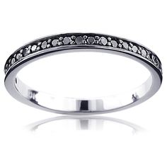 This gorgeous 10K Gold Slim Stackable Black Diamond Womens Wedding Band showcases 0.21 carats of sparkling black diamonds. Featuring a simple classic design, this stylish stackable wedding band is available in 10K, 14K, 18K white, yellow and rose gold and can be customized with different color diamonds.