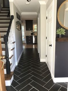 Enjoy a quick post with before and after pictures of a 1963 original hallway transformed into a herringbone hallway tile floor. Enjoy a quick post with before and after pictures of a 1963 original hallway transformed into a herringbone hallway tile floor. Entryway Flooring, Kitchen Flooring, Tile Entryway, Home Renovation, Home Remodeling, Herringbone Tile Floors, Herringbone Pattern, Tiled Hallway, Black Hallway
