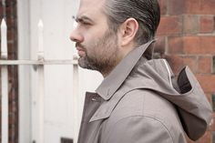 Hooded jacket made from taupe-grey Ventile cotton.
