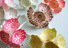 Paper and stamped flowers made by The Gilded Bee and found via Cutetape shop.