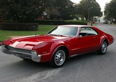 1966 Oldsmobile Toronado - First and foremost it was a front-wheel drive car with a powerful V8 engine, which was definitely not too common back in the day. Besides that, it was also a luxury automobile in a very aggressive body.-