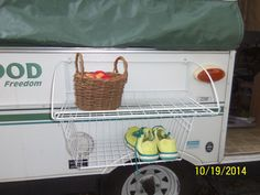 Love this idea (from Popup Campers on FB)! Outside storage is sorely lacking on our pup...this set up would come in handy.