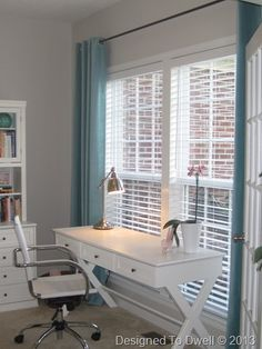 Home office with Sanela turquoise curtains -- also some great practical tips on styling bookshelves