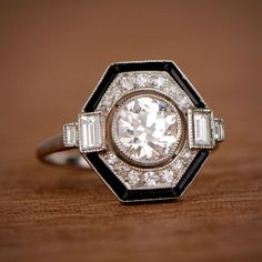 A beautiful and bold Art Deco Style Engagement Ring framed with onyx and featuring an old European cut diamond.
