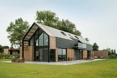 Sito-architecten recently transformed an old barn into a stunning modern home.