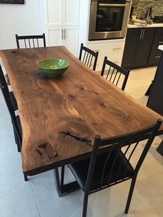 Gorgeous black walnut dining table with 1x3 metal trapezoid legs. Finished with a polyx hand rubbed wax.
