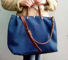 995abc598b Waxed canvas tote bag with leather handles and leather shoulder strap