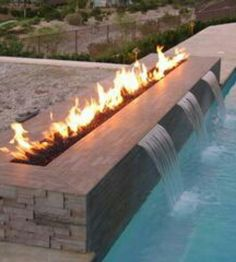 Firepit/Fireplaces # 7 Wow. I like this but I'd probably forget the fire was up there, pull myself up on it and burn my buns!