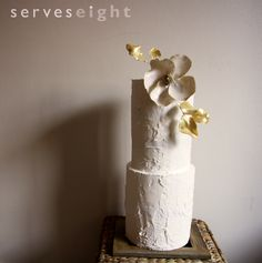White and gold rough iced wedding cake!