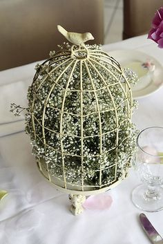Add a sweet vintage touch to the tables with accents like antique bird cages and origami hearts. | 14 Ways To Bring Vintage Glamour To Your Wedding