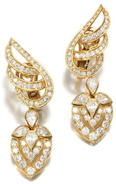 PAIR OF DIAMOND EAR CLIPS, GRAFF.   Each surmount designed as stylised open work leaf, set with brilliant-cut diamonds, to a detachable pendant accented with pear-shaped and brilliant-cut diamonds.