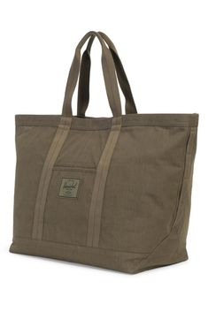 This carryall tote has pockets to keep essentials organized.