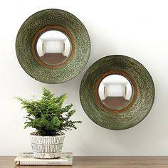 Our Lu Mirror is like a small work of light-filled sculpture. The convex mirror is framed in a thin-walled bowl of iron with weathered jade green finish. A rim of antique gold accentuates the round shape. Lu Mirror features:Hand applied finishHandmade