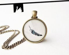 Feather necklace  Handmade pendant necklace with original tiny drawing under glass.   This is an ink on paper hand-drawn feather. The original drawing closed under glass in brass setting. TotemSwan artistic jewelry