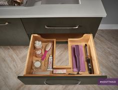 KraftMaid's roll-out trays are thoughtfully designed to fit around plumbing and extend fully, making use of often wasted space in your bathroom vanity.